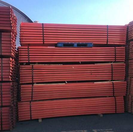 red beams ready for transport into warehouse